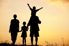 Silhouette, happy children with mother and father, family at sun